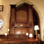 The vestry entrance is to the right of the organ.